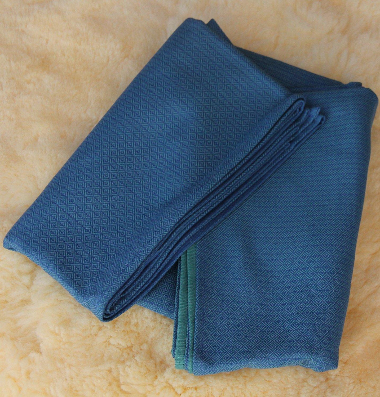 5da73e32d1b Storchenwiege Leo Turquoise Baby Wrap